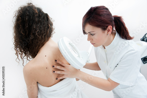 woman at dermatology examination