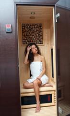 woman in compact sauna