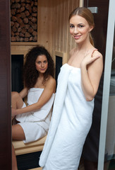 two woman in compact sauna