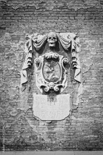 Ancient spooky relief on a church wall