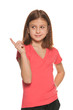 Pretty girl in red blouse makes a hand gesture