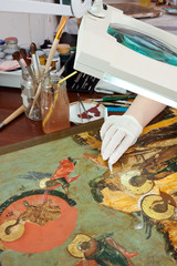 Closeup of  restoration of ancient icons