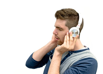 young man enjoying music with white headset