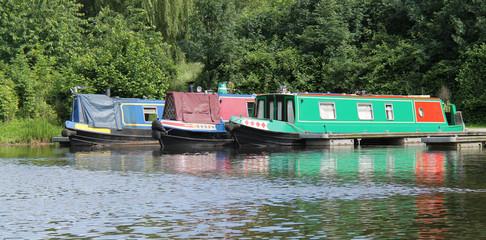 Three Narrow Boats at a Canal Mooring Point.
