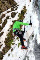 mountaineer on ice wall