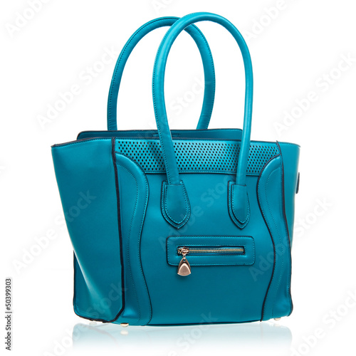 Fashion female handbag over white background
