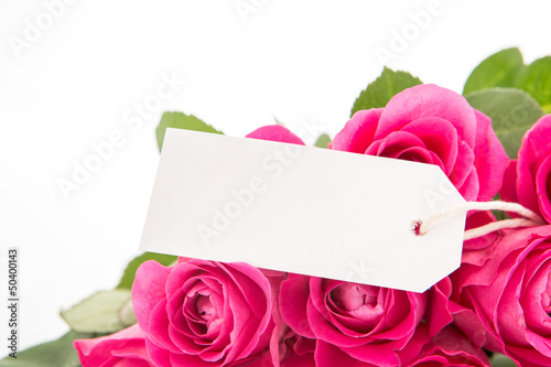 Close up of a beautiful bouquet of pink roses with a blank day c