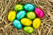 Easter eggs grouped together on straw