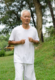 asian senior male jogging outdoor park