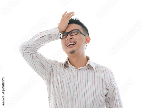 asian chinese male having headache with isolated white backgroun