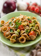 orecchiette with bean broad and fresh tomatoes, selective focus
