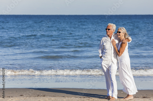 Happy Senior Couple Embracing on Tropical Beach