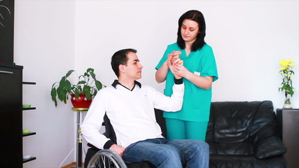 Physical therapist working with disabled patient