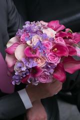 wedding bouquet for bride in hands of groom