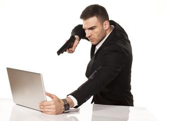 businessman destroying his laptop using guns