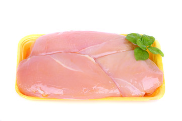 Raw chicken breast in yellow plastic tray