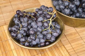 Black grape in copper bowl