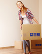 Young beautiful woman with packages for house moving
