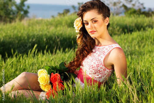 Beautiful woman  with flowers in her hair