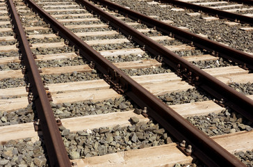 Rails sleepers and stones background.