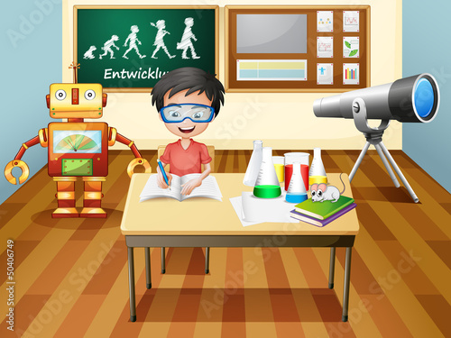 A boy inside a science laboratory