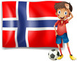 A boy with a soccer ball in front of the flag of Norway