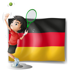 A boy playing tennis in front of a flag
