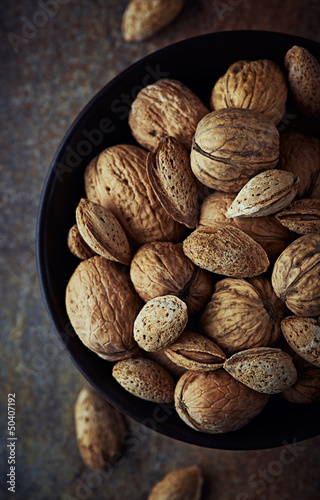Bowl of rustic walnuts and almonds