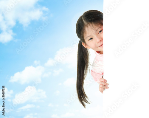 Asian girl hiding behind a blank white card