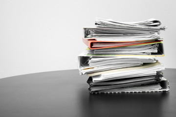 stack of folders and documents on office table