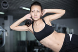 Woman at the gym doing exercises to strengthen abdominal muscles poster