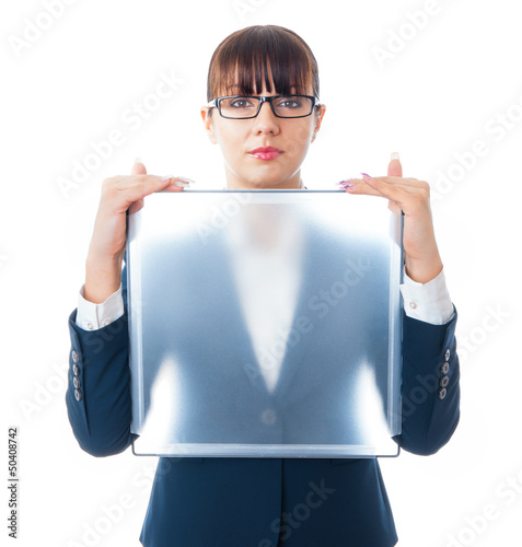 Portrait of a businesswoman showing blank signboard