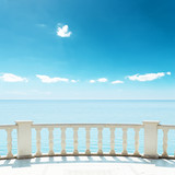 balcony near sea under deep blue sky