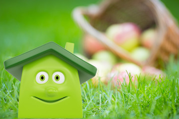 Eco green house against apples