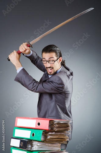 Man with sword and paper