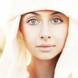 Portrait of calm beautiful young woman in head scarf close up
