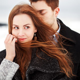 Young couple outdoor sensual portrait in cold windy weather