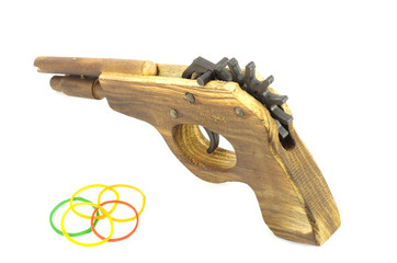 Wooden Catapult Gun with rubber on white background