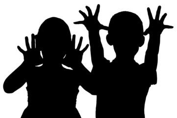 Silhouette frightening children