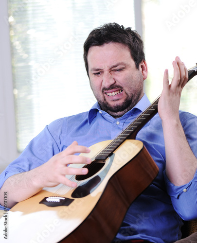 Male adult hate playing guitar