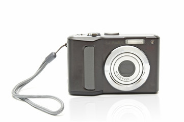 Digital compact camera on white background