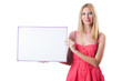 Woman in pink dress with blank board