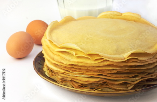 Stack of thin pancakes on a plate