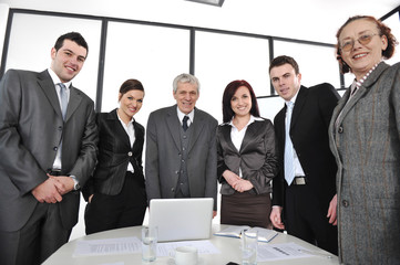 Group of business people standing at office and smiling
