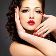 Fashion model with red nails