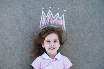 Young girl with chalk drawn crown