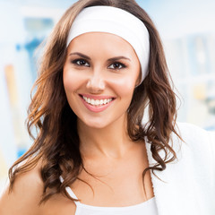 Young smiling woman at fitness club