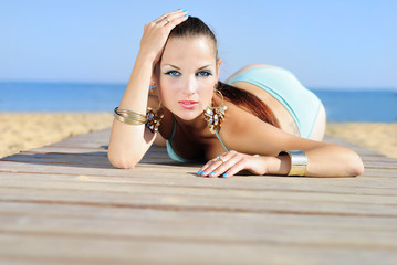 Graceful girl in blue swimsuit ashore epidemic deathes
