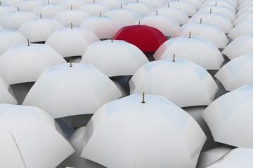 Red umbrella among other white umbrellas