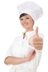 young chef woman in white uniform with thumb up